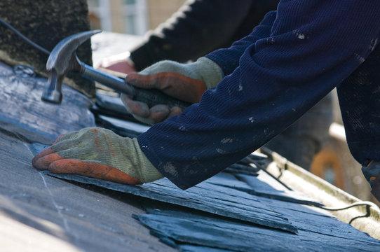 Roofer hammering close up
