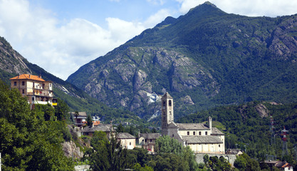 a typical italian village with mountains