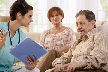 Healthcare worker at home of pensioners