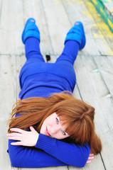 laying redheaded girl
