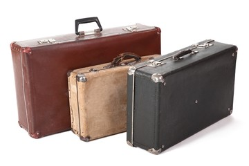 three old suitcase. focus on corner of yellow suitcase. isolated