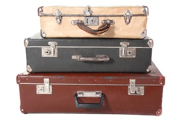 three dirty dusty suitcases. suitcases is closed. Isolated