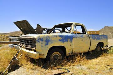 CAR WRECKAGE ON THE DESERT
