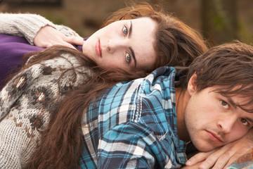 Portrait Of Romantic Young Couple In Autumn Landscape