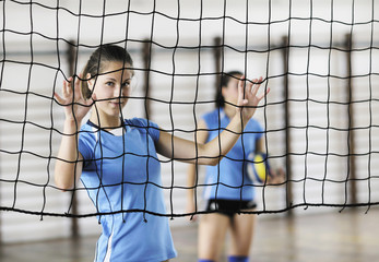 girls playing volleyball indoor game