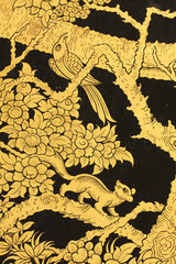 Golden bird and squirrel in Thai style painting.