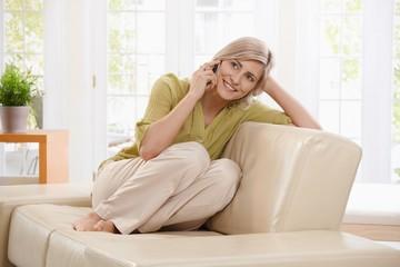 Woman on call on sofa