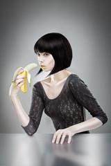 brunette holding banana