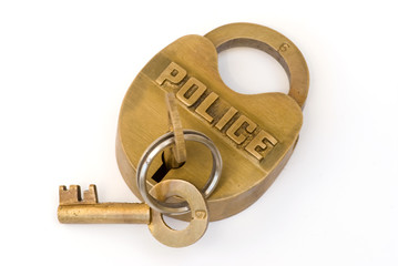 Brass police lock with key in lock