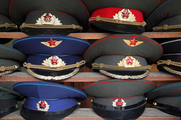 ussr polisman uniform hats with visor on wooden shelf