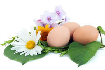 Easter eggs in a nest from flowers