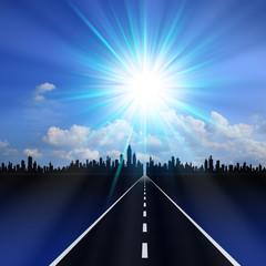 ビル街と道路と太陽