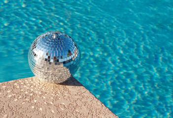 Disco ball beside resort swimming pool