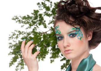 Close-up of sprite girl with faceart and plant