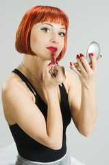 Red girl with lipstick and mirror
