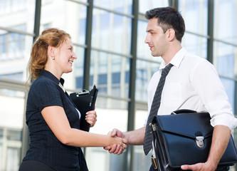 Handshake between office workers