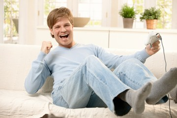 Laughing guy with computer game