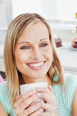 Portrait of a relaxed woman holding a cup of coffee