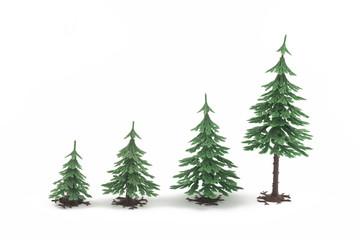 Four plastic fur-trees on white background