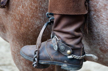 Cowboy boot with spur and horse