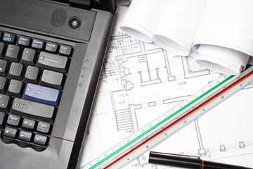 Laptop and architect blueprints