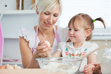 Happy mother and daughter baking together