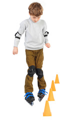 little boy rollerblading near orange cones looking down isolated