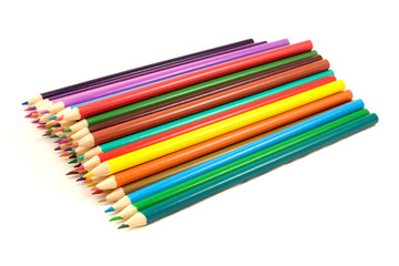 pile of multicolored pencils on white background