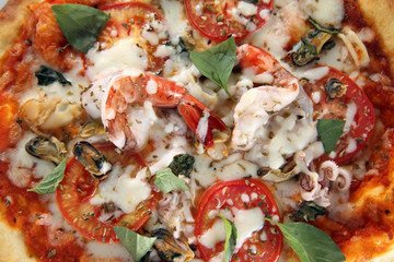 pizza seafood with basil leaf