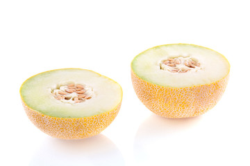 two cut half pieces of melon isolated over white