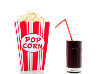 snacking popcorn and drinking cola with a red straw isolated ove