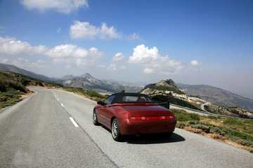 Sport car cabriolet across Sierra Nevada in Spain