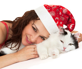 Beautiful girl in a New Year hat with a cat.
