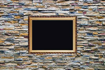 the bright ornamental stone wall with old style wodden frame wit