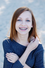 Girl with braces smiling cheerfully