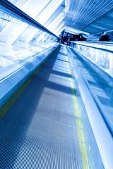 blue moving escalator way