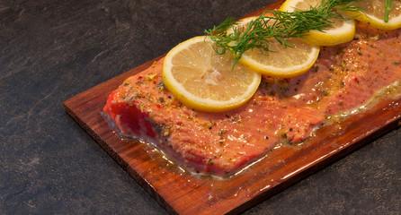 Sockeye salmon on cedar with lemon and dill