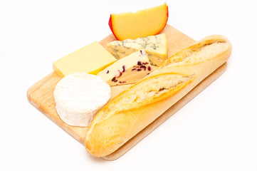 selection of cheese and bread ona wooden board isolated
