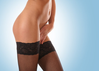 Beautiful body of a young female in stockings