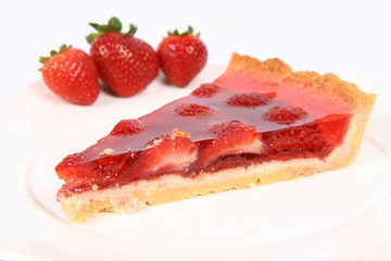 Piece of Strawberry Tart on a white plate with strawberries