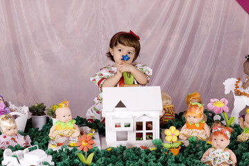 Baby girl and doll house