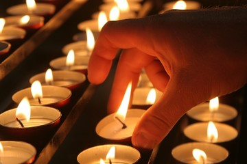 hand of man with the candle