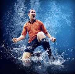 Water drops around football player under water on blue backgroun