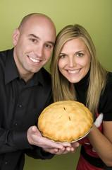 Couple holding pie