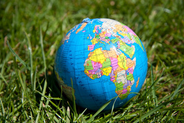 a colorful Globe on a lawn