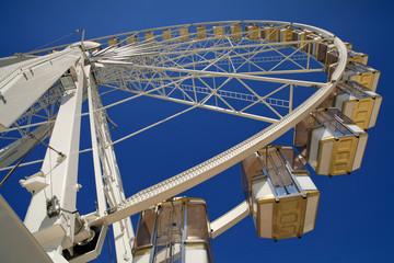 Parisian Ferris wheel against a deep blue sky