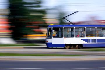 Old blue tram rider fast on rails, Wroclaw, Poland
