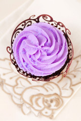 cupcake with lavender top in festive wrap on beige