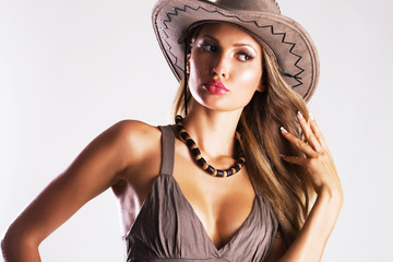 Beautiful woman in cowboy's hat