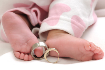 wedding rings on the toes of a baby girl